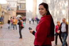 Woman with headphones, listening to audio guide Stock Photography