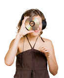 Woman in headphones listening to music Stock Images