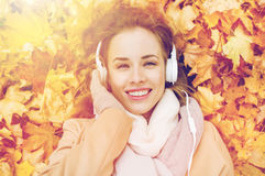 Woman with headphones listening to music in autumn Stock Photo