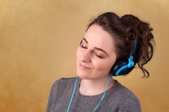 Woman with headphones listening to music with copy space Royalty Free Stock Image
