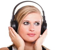 Woman with headphones listening to music isolated. Woman with headphones listening to music - isolated over a white background royalty free stock photos