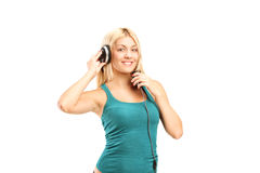 Woman with headphones listening to music Royalty Free Stock Images
