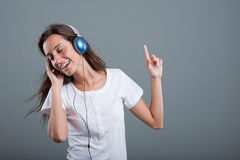 Woman with headphones listening to music Royalty Free Stock Photography