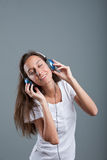 Woman with headphones listening to music Stock Photography