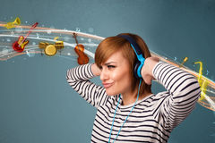 Woman with headphones listening to music Stock Image