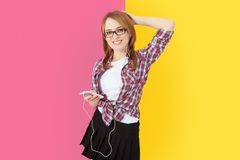 Woman with headphones listening to music on smartphone. Stock Photography