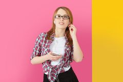 Woman with headphones listening to music on smartphone. Royalty Free Stock Image