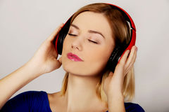 Woman with headphones listening to music. Royalty Free Stock Photos