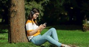 Woman in headphones listening to music stock video
