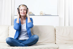 Woman in headphones listens to music Royalty Free Stock Photos