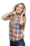 Woman in headphones looking to the side Royalty Free Stock Image