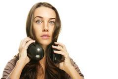 Woman with headphones making big eyes Stock Image
