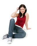 Woman with headphones and mp3 player Royalty Free Stock Photography