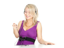 Woman in headphones and MP3 player Royalty Free Stock Image