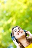 Woman with headphones outdoors Royalty Free Stock Images