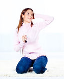 Woman with headphones. Pretty young woman with headphones listening music at home Royalty Free Stock Images