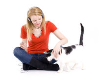 Woman in headphones relaxing with her lovely cat Royalty Free Stock Image