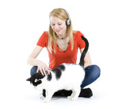 Woman in headphones relaxing with her lovely cat Royalty Free Stock Photography