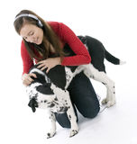 Woman in headphones relaxing with her lovely dog Royalty Free Stock Photos