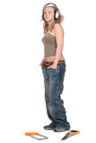 Woman in headphones with a saw Stock Image