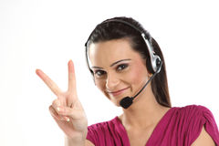 Woman with headphones showing victory sign Stock Images