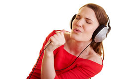 Woman with headphones singing Royalty Free Stock Image