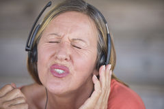 Woman with headphones singing to music Royalty Free Stock Photo