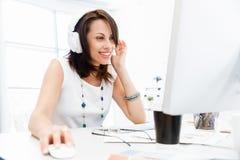 Woman in headphones Stock Photo