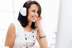Woman in headphones Royalty Free Stock Photography
