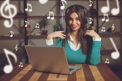 Woman and headphones Royalty Free Stock Photography