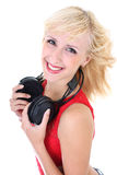 Woman with headphones smiling Stock Images
