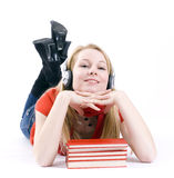 Woman in headphones with stack of books Royalty Free Stock Images
