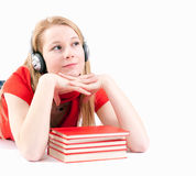 Woman in headphones with stack of books Stock Photo