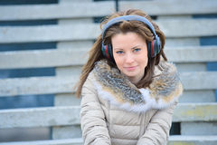 Woman in headphones on street stairs Royalty Free Stock Photography