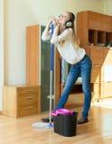 Woman in headphones washing the floor Stock Photo