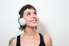 Woman with headphones on white background Royalty Free Stock Images