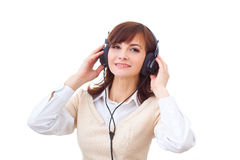Woman with headphones on the white background royalty free stock image