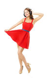 Woman in headpnones dancing listening to music, isolated over white Royalty Free Stock Images