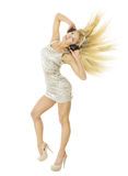 Woman in headpnones dancing listening to music, isolated over white. Woman in headpnones dancing listening to music. Girl portrait long flying hair isolated over stock images