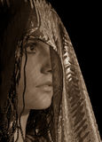 Woman in headscarf. On black stock images