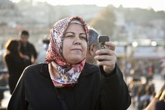 Woman in Headscarf taking photo Royalty Free Stock Photos