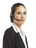Woman with headset 1. A woman with headset phone looking compassionate Royalty Free Stock Images