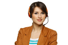 Woman in headset. Smiling cheerful support phone operator woman in headset, isolated on white background Stock Photography
