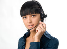 Woman with headset. Young attractive woman with headphones with microphone stock images