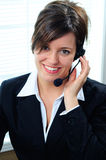 Woman And Headset Royalty Free Stock Images