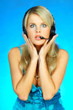 Woman with a Headset. Young pretty woman wearing a phone headset stock images