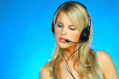 Woman with a Headset. Young pretty woman wearing a phone headset royalty free stock image