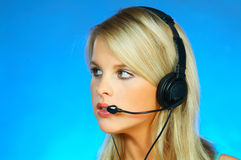 Woman with a Headset. Young pretty woman wearing a phone headset stock photo