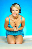 Woman with a Headset. Young pretty woman wearing a phone headset stock photography