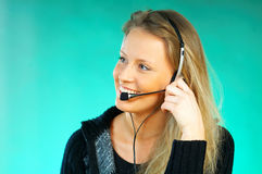 Woman with a Headset. Young pretty woman wearing a phone headset royalty free stock photos